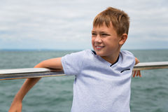 Portrait of a boy looking at the sea side Stock Photography