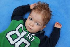 Portrait of boy lying on floor Royalty Free Stock Photo