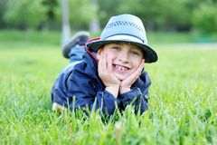 Portrait of boy lying on green grass Royalty Free Stock Photo