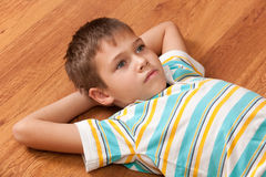 Portrait of a boy lying on the woo Stock Photos