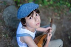 Portrait of a boy with a mandolin. Stock Images