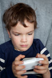 Portrait of boy with mobile phone Royalty Free Stock Photography