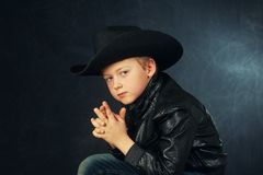 Portrait of a boy model in a leather jacket and hat royalty free stock photos