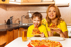 Portrait of boy and mother ready to eat pizza Royalty Free Stock Photography