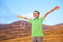Portrait of a boy on mountains Stock Image