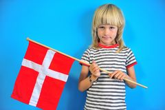 Portrait of a boy with flag of Denmark royalty free stock photo