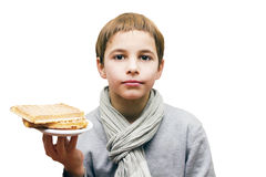 Portrait of a boy offering a waffle - isolated on white. Portrait of a cute boy offering a waffle - isolated on white Royalty Free Stock Images