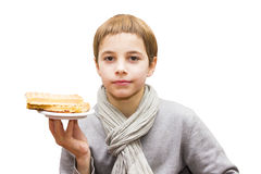 Portrait of a boy offering a waffle - isolated on white. Portrait of a cute boy offering a waffle - isolated on white Royalty Free Stock Photography