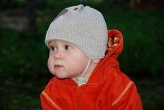 Portrait of boy in orange jacket. Looking away Stock Photo