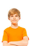 Portrait of a boy in orange shirt on white Stock Photos