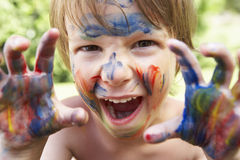 Portrait Of Boy With Painted Face and Hands Stock Image
