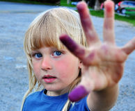Portrait of a boy with painted fingers. Portrait of a boy with a painted fingers stock photography