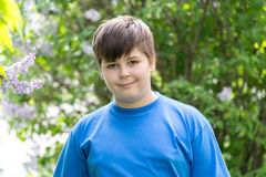Portrait of boy in park with blooming lilacs Stock Photography