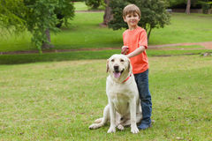 Portrait of a boy with pet dog at park Royalty Free Stock Photo