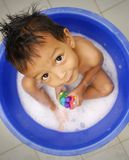 Portrait boy play in bath Royalty Free Stock Photos