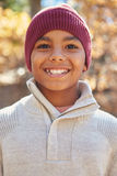Portrait Of Boy Playing In Autumn Woods royalty free stock images