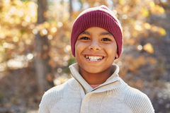 Portrait Of Boy Playing In Autumn Woods stock photos