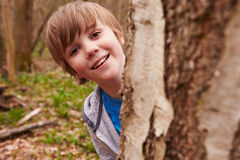 Portrait Of Boy Playing Game In Forest Stock Photo