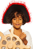 Portrait of a boy playing pirate steering helm Stock Photography