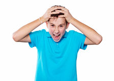 Portrait of a boy pointing finger showing emotions expressive on a white background with a blue shirt Stock Image