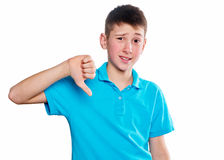 Portrait of a boy pointing finger showing emotions expressive on a white background with a blue shirt Royalty Free Stock Photo