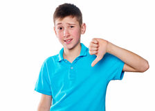 Portrait of a boy pointing finger showing emotions expressive on a white background with a blue shirt Royalty Free Stock Images