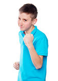 Portrait of a boy pointing finger showing emotions expressive on a white background with a blue shirt Stock Photos