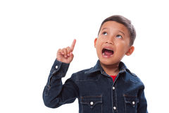 Portrait of boy pointing finger up. Royalty Free Stock Photography