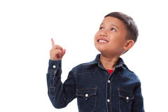 Portrait of boy pointing finger up. Royalty Free Stock Photos