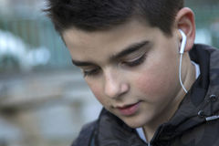 Portrait of a boy. With headphones outdoors stock images
