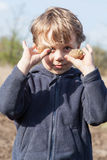 Portrait of boy with potatoes Royalty Free Stock Photos