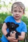 Portrait of boy with puppy Royalty Free Stock Photo