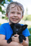 Portrait of boy with puppy Royalty Free Stock Image
