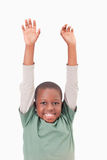 Portrait of a boy raising his arms Royalty Free Stock Image