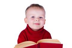 Portrait boy reading a book Stock Photos