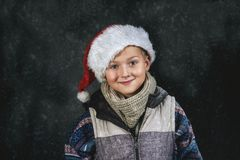 Portrait of a boy in the Santa hat Stock Photos