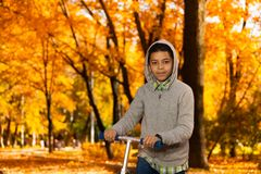 Portrait of boy with scooter Stock Images