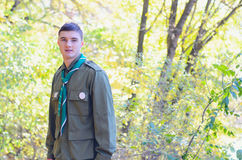 Portrait of Boy Scout in Forest on Sunny Day Royalty Free Stock Photography