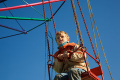 Portrait of boy seated in carousel Royalty Free Stock Images