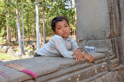 Portrait of a boy selling incense sticks. In the temple of Bayon Siem Reap Cambodia Royalty Free Stock Image