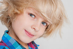 Portrait of a boy. The boy shake blond hair Royalty Free Stock Images