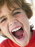Portrait Of Boy Shouting Stock Photography