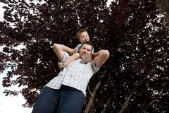 Portrait Of Boy Sitting On Father's Shoulders. Portrait Of Cute Little Boy Sitting On Father's Shoulder Stock Image