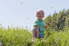 Portrait of a Boy in the sky and grass Royalty Free Stock Image
