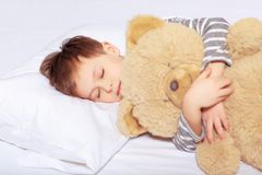 Portrait of a boy sleeping with teddy bear Stock Images