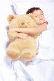 Portrait of a boy sleeping with teddy bear Royalty Free Stock Photos
