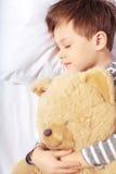 Portrait of a boy sleeping with teddy bear Royalty Free Stock Image