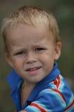 Portrait of a boy. Portrait of a slyly little boy smiling Stock Images