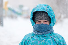 Portrait of a boy during a snowstorm Stock Photos