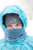 Portrait of a boy during a snowstorm Stock Images